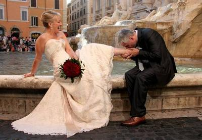 Our wedding day, taken at the Trevi Fountain, Rome, Italy.