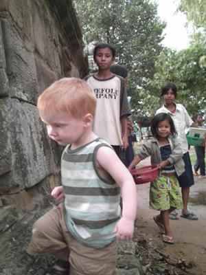 Gavin and local kids at a temple in Cambodia